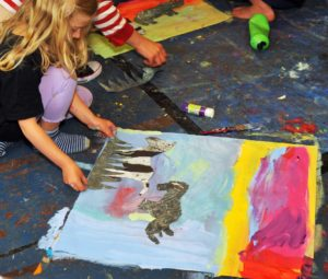 collaging animals into painting of the savanna